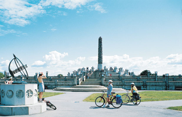 Oslo towns cities Vigeland Sculpture Park The Monolith and the sundial young boys on bicycle tour nature culture activity, Norwegen